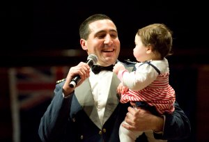 Action shots from the 2012 Air Force Proms - Owen Clarke with his baby daughter at the end of the Proms concert
